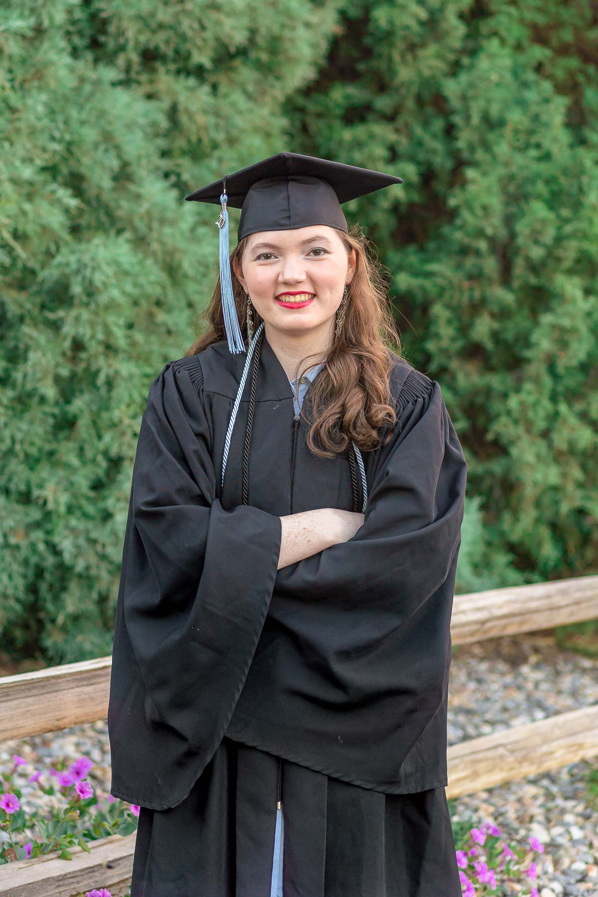 girl in high school graduation gown and cap